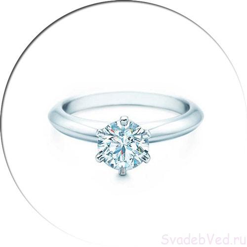 Кольцо с камнем круглой формы